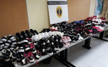 La Policía descubre un taller ilegal al aire libre y una furgoneta con zapatillas falsificadas